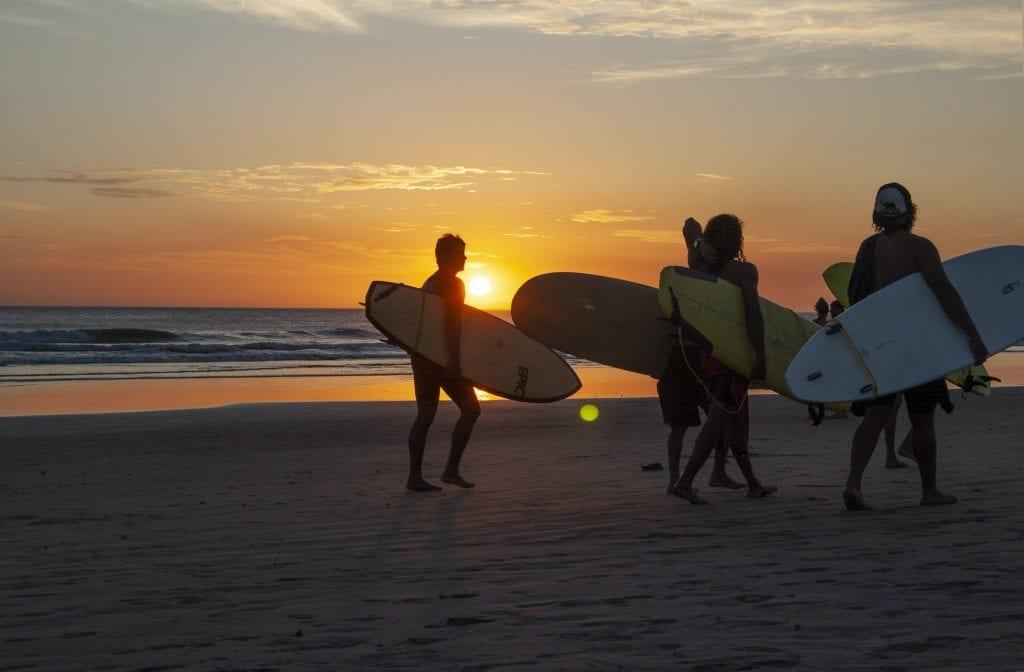 friends surf sunset beach costa rica