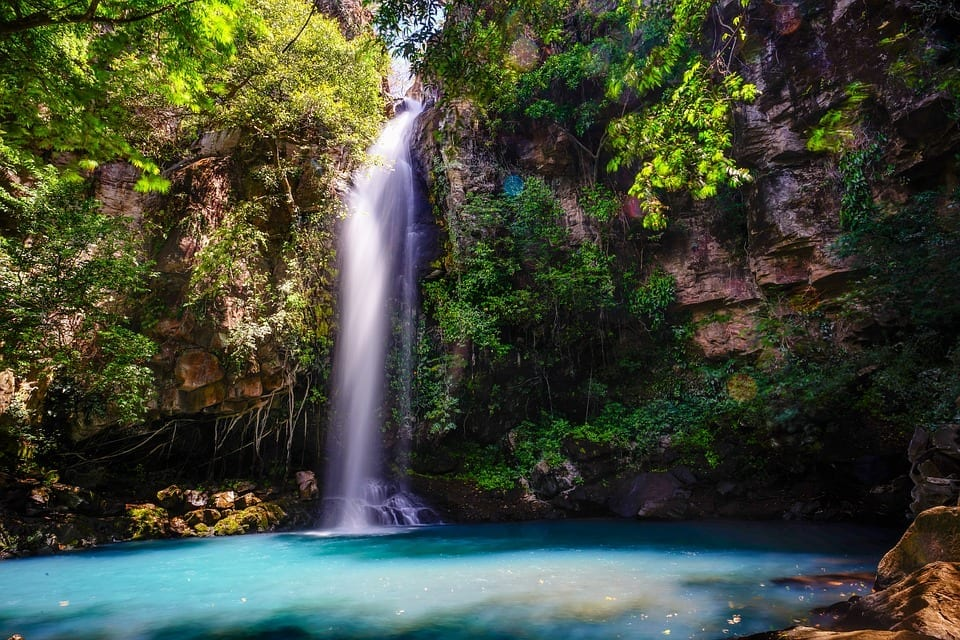 waterfall in costa rica with blue pool